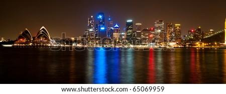 Sydney skyline and harbor at night taken from North Sydney. - stock photo