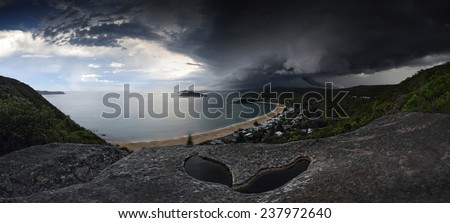 Sydney summer supercell thunderstorm shot in extreme conditions with heavy rain.  The supercell is forming funnel clouds  dropping from its lower shelf, when they touch ground a tornado is born. - stock photo
