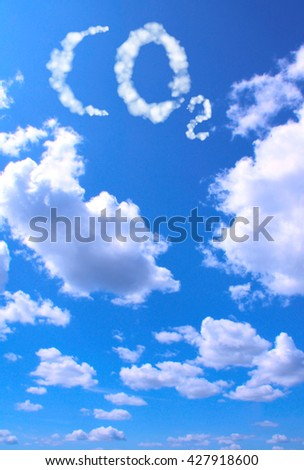 Symbol CO2 from clouds on blue sku background - stock photo