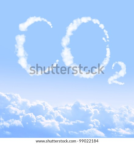 Symbol CO2 from clouds on blue sky - stock photo