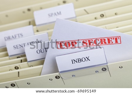 Symbol for e-mail privacy - a file folder with inbox, outbox and spam - stock photo