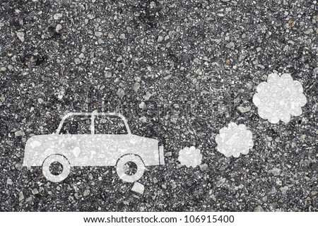 Symbol of a polluting car painted on the surface of an asphalt road. - stock photo