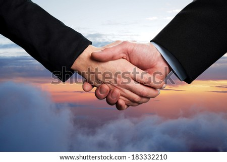 Symbol of agreement, business handshake - stock photo