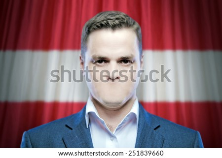 Symbol of censorship and freedom of speech: a young man without a mouth on a background of the national flag of Ausria - stock photo