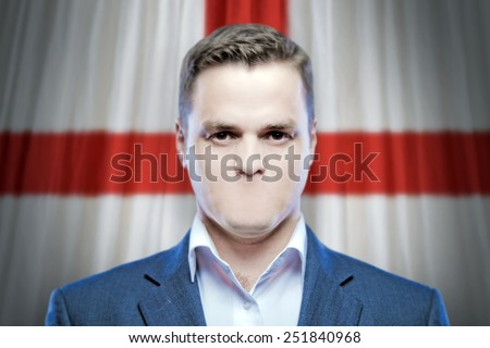 Symbol of censorship and freedom of speech: a young man without a mouth on a background of the national flag of England - stock photo