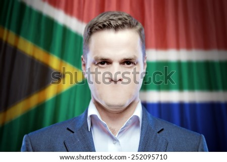 Symbol of censorship and freedom of speech: a young man without a mouth on a background of the national flag of South Africa - stock photo