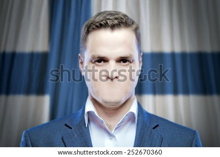 Symbol of censorship and freedom of speech: a young man without a mouth on a background of the national flag of Finland - stock photo