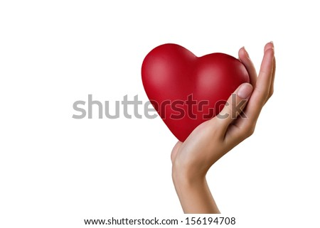 symbol of heart on woman`s palm on grey background