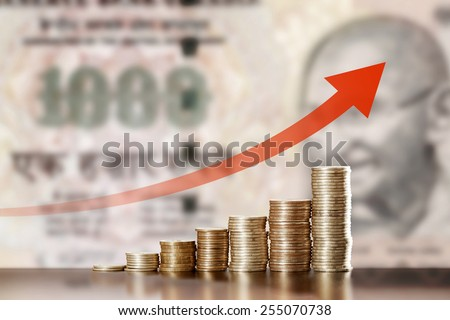 Symbol of inflation and currency fluctuations: Appreciation of the Indian rupee - stock photo