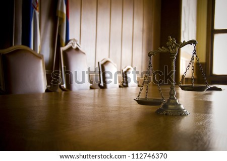 Symbol of law and justice in the empty courtroom, law and justice concept - stock photo