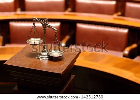 Symbol of law and justice in the empty courtroom, law and justice concept. - stock photo