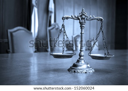 Symbol of law and justice, law and justice concept, focus on the scales, blue tone - stock photo