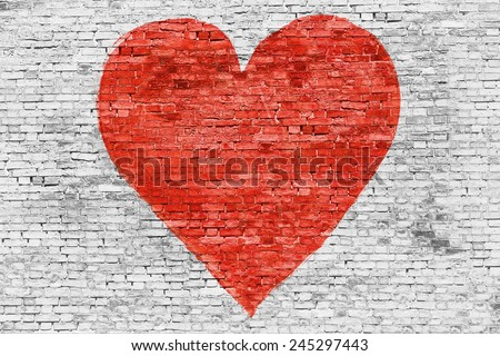 Symbol of love painted on white brick wall