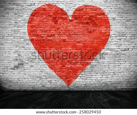 Symbol of love painted on white brick wall - stock photo