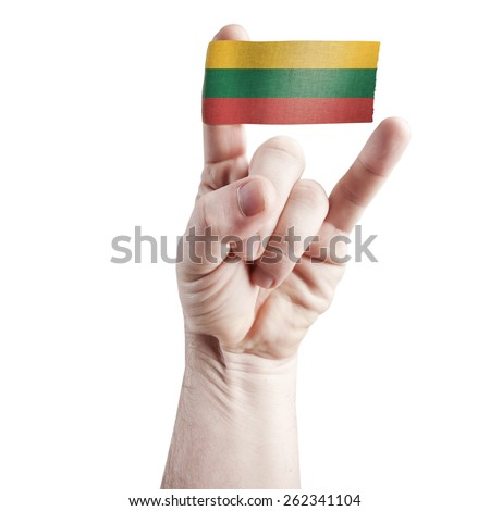 Symbol of national coolness: rock hand - symbol of the horns with the flag of Lithuania - stock photo