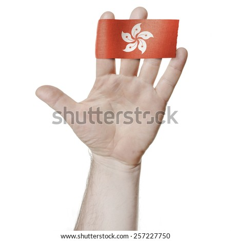 Symbol of national honor: the open palm of the hand with the flag of  Hong Kong