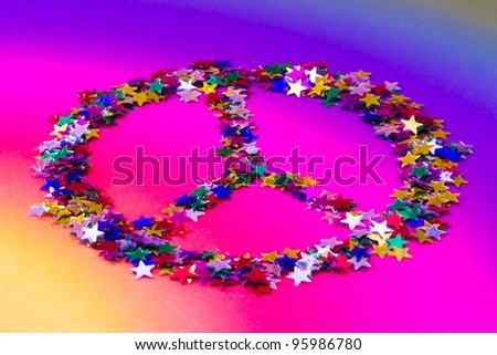 symbol of peace made up of colorful stars