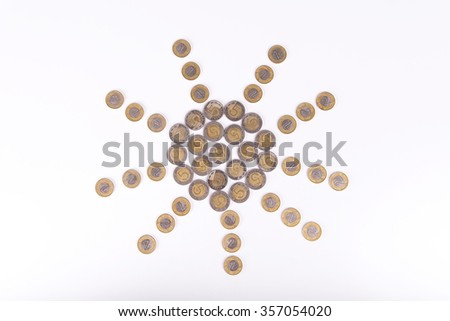 Symbol of sun made from Polish zloty coins. Symbolizes good fortune in business, large income, earnings, or winning the lottery.