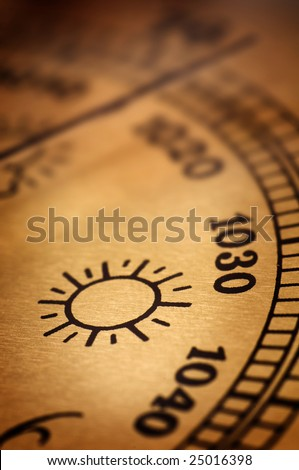 Symbol of sunny weather on an old barometer