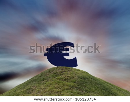 Symbol of the Euro currency over the hill against a surreal cataclysmic sunset for the concept of declining Euro value. - stock photo