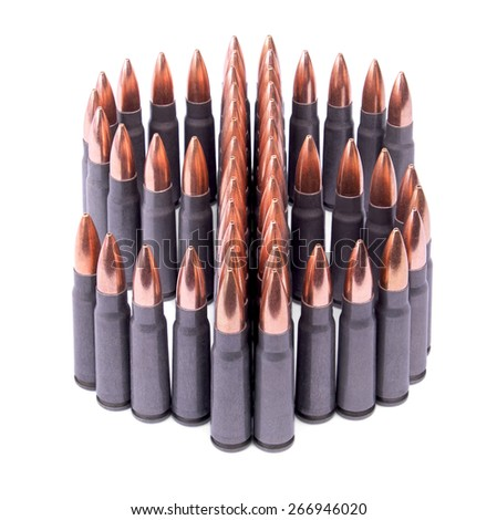 Symbol of the US dollar made of ammunition on white background.