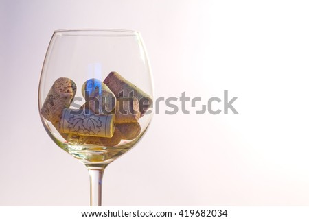 Symbol of wine drinking. Wine glass filled with bottle corks - stock photo