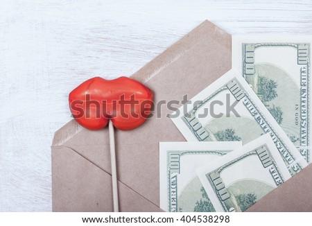 symbol selling love and money bribe. money, women's lips - stock photo