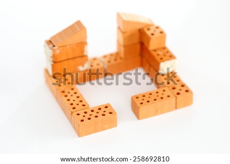 symbolic beginning of a red house wall - stock photo