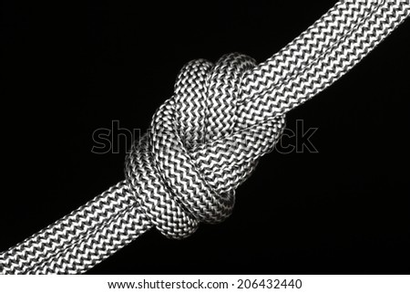 symbolic diagonal eight knot with black background