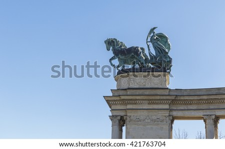 Symbolic figures at the top of the colonnade - allegorical image: War, Peace, Work, Welfare.Heroes Square in Budapest - stock photo