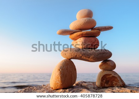 Symbolic figurine of inukshuk of the pebbles - stock photo