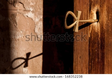 Symbolic key of life inserted into the door the temple built for Pharaoh Ramesses II in the 13th century BC at Abu Simbel. - stock photo