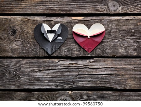 Symbolic male and female heart shapes. On old vintage wooden background. Wedding or st.Valentine theme. - stock photo