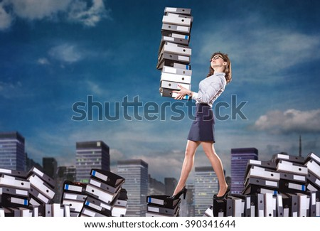 symbolic picture for the hard work with a female clerk and a big mountain of work - stock photo