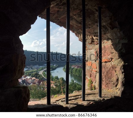 symbolic prison theme with panoramic view outside a barred window at Wertheim Castle in Southern Germany - stock photo