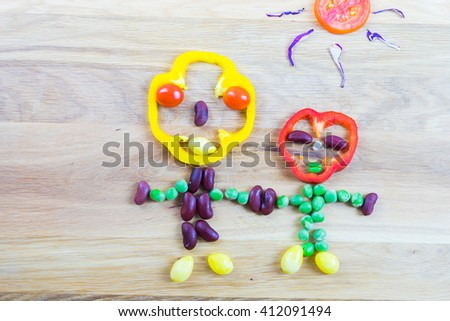 Symbolical man and woman  made of vegetables as symbol and sign for vitality and healthy lifestyle - stock photo