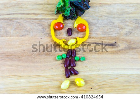 Symbolical man made of vegetables as symbol and sign for vitality and healthy lifestyle - stock photo