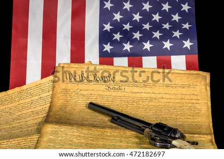 Symbols of America with a handgun and constitution with flag