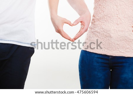 Symbols of love. Couple showing their connection and feelings by holding their hands strongly in shape of heart. Body language as expression of mind state.