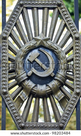 Symbols of the Soviet Union in the old gate - stock photo