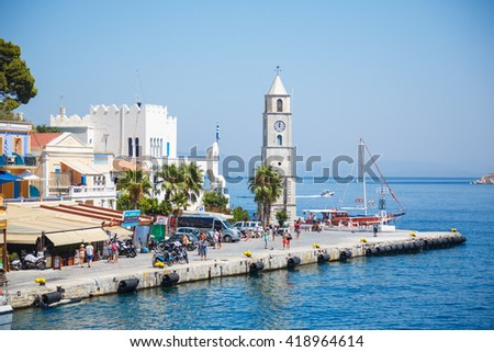 SYMI, GREECE - September 6,2015: Looking down central chapel in Yialos harbour on Symi island, Greece. Symi is easy and most popular destination for day tripping from Rhodes island. - stock photo