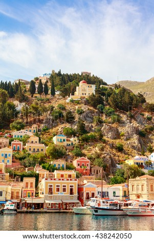 SYMI ISLAND, GREECE - JUNE 11, 2016: Neo-Classical houses in picturesque harbor on the island of Symi in Agean Sea. - stock photo