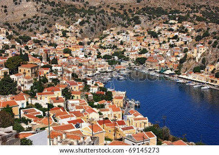 Symi island, Greece. Panoramic view of picturesque Gyalos and its harbor. - stock photo