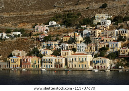 Symi village on island of Symi near island of Rhodes (Greece). Typical greek houses - stock photo
