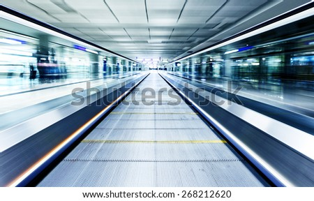 symmetric moving blue escalator inside contemporary airport, hong kong - stock photo