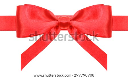 symmetric red satin bow with vertically cut ends on ribbon close up isolated on white background