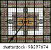 Symmetrical composition in stained glass in the roof of the main hall of a fully decorated art deco building, a former brewery office in Breda, the Netherlands, with stained glass in the wall - stock photo