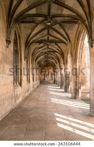 Symmetrical Old Castle Corridor in Golden Sunlight - stock photo