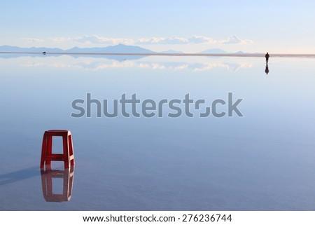 Symmetry scenery at Uyuni salt flat - stock photo