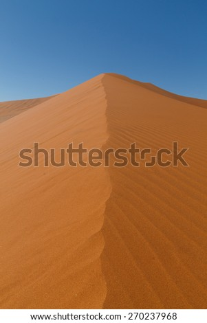 Symmetry view over a dune from Hidden Vlei, Sossusvlei Namibia - stock photo